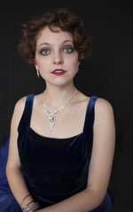 Beautiful young woman in blue velvet dress