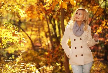 Autumn Woman. Fall. Blonde Beautiful Girl