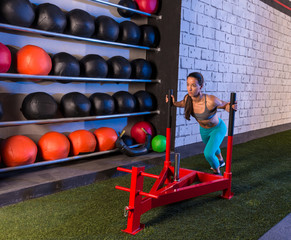 sled push woman pushing weights workout