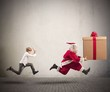 Angry child chasing Santa Claus