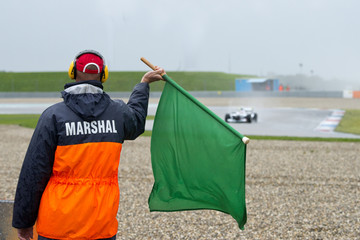 Marshal waving a green flag