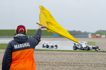 Marshal waving yellow flag
