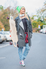 Pretty Woman in Cool Casual Attire with Skateboard