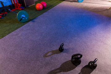 Kettlebells and Barbells in a gym