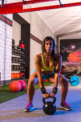 brunette girl kettlebell swing weightlifting
