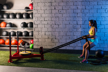 sled rope pull woman pulling weights workout