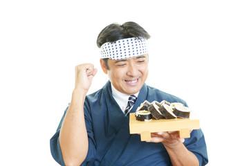 ガッツポーズの寿司職人