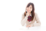 Fototapety young asian woman studying on white background