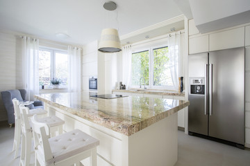 Kitchen island in bright house