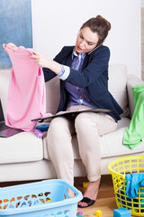 Woman working and folding clothes