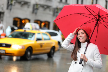 New York City Manhattan woman with fall umbrella