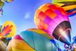 Leinwandbild Motiv Bright Hot Air Balloons Glowing at Night