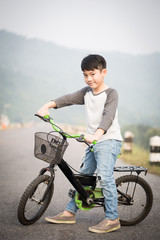 Asian Boy on bicycle