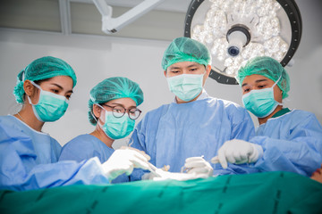 Doctor and Surgery team operating