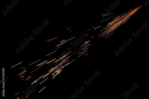 Leinwandbild Motiv Glowing Sparks in the Dark