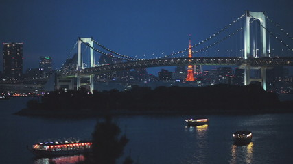 Two famous Tokyo landmarks. Rainbow Bridge and Tokyo Tower