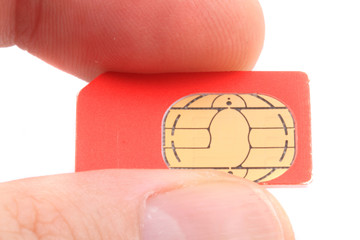 cellphone cimcard in the human fingers