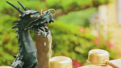 Dragon fountain spout at an ancient Japanese shrine