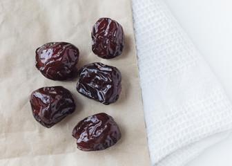 Dried prune on paper bag