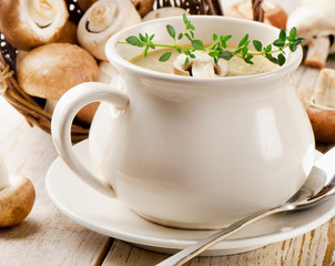 Creamy  soup and fresh mushrooms.