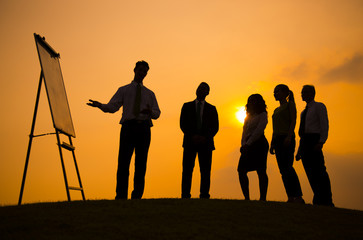 Silhouette of Business People on the Hill