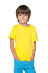 Cute little boy in a yellow shirt