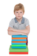Young boy near books