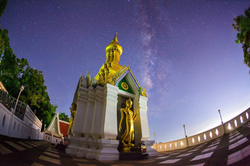 Milky Way at Standing gold Buddha image name is Wat Sra Song Pee