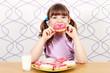 little girl eating sweet donuts