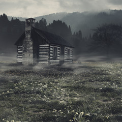 Spooky landscape with alone haunted house against dark mountain