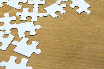 White puzzle on wood background