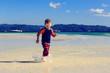 little boy running on sand beach