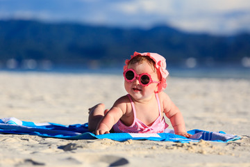 cute little baby girl on tropical beach