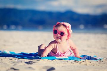 cute little baby girl on tropical beach
