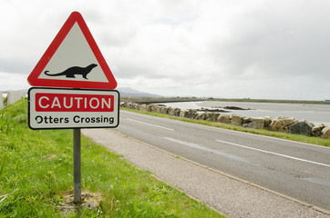 Road sign on a countryside road warning for otters crossing