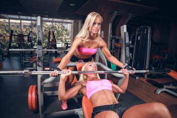 Beautiful girls in fitness club