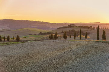 Yellow sunset in amazing Tuscany landscape