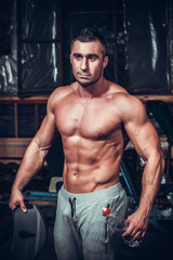 muscle man who is posing