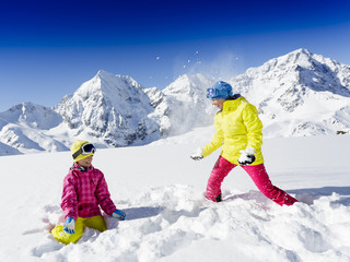 Ski and winter fun - skiers enjoying winter vacation
