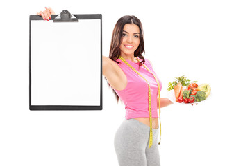 Girl holding clipboard and a plate with vegetables