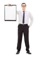 Young businessman holding a clipboard