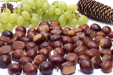 Chestnuts and grapes on white