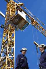 building workers with mobile construction cranes