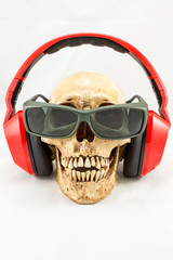 Skull with red headphone and sunglasses on white background