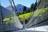 Suspension bridge in the Alps - 71933936