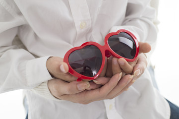 Parent and child to have a heart-shaped sunglasses