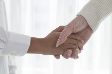 Hand of parent and child that handshake