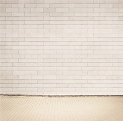 Light grey brick wall texture with walkway.