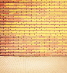 Colorful brick wall texture with walkway.