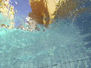 Air bubbles in clear blue water in pool (underwater shot)